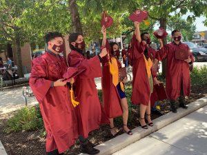 Six graduates celebrate.