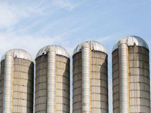 four farm silos